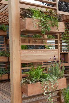 Great pergola/planter idea~ and makes the pergola more cozy.