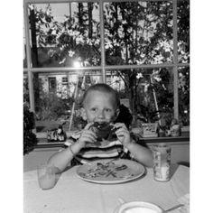 Boy eating Canvas Art - (24 x 36)