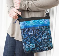 Want to get out the door on time carrying just a few essentials you have in mind? It pays to have a beautiful Barbados Bag that makes organization easy while busting the bulk. Create your own using this kit featuring a pattern designed by Nancy Green and batiks from Anthology Fabrics. This bag is perfect for carrying your tablet, phone and other necessities, and the crossbody strap will keep your purse close and your hands free. Plus, the Barbados Bag pattern is perfect for fat quarters, so…