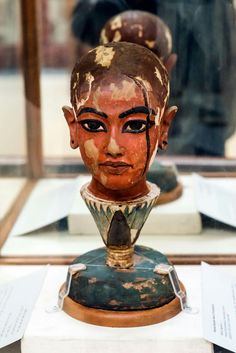 Sculpture of head of Tutankhamun emerging from lotus flower Carved of wood then plastered and painted at Egyptian Museum Cairo.