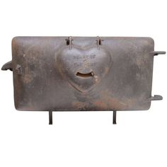 Cast Iron Stove Door with Hinged Heart   From a unique collection of antique and modern primitives at http://www.1stdibs.com/furniture/folk-art/primitives/