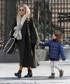 Actress Sienna Miller was seen crossing paths with fellow actress Claire Danes and her husband Hugh Dancy on a street corner while out for a stroll with her daughter Marlowe Sturridge in Manhattan's Downtown area in New York City, New York on March 13, 2017.
