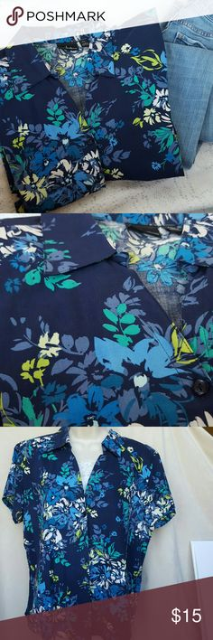 """Navy Short sleeve flowered top Navy button up short sleeve top.  Size petite XL.  I normally don't wear petite but it's 24"""" long,  22"""" pit to pit buttoned.  Fits more like a large.  Fun colors to wear with denim or white.  Great condition! Erika Tops Blouses"""