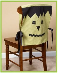 Halloween-themed chair covers--a ghost, a Jack-o-lantern, and bats would also be very easy to make