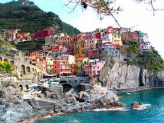 Cinque Terre, Italy.  Stretch of coastline with villages, olive groves, vineyards and hiking trails.  So much to see.  So beautiful.  It's at the top of the list of my favorite places in the world.