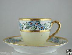 ANTIQUE LIMOGES DEMITASSE CUP/SAUCER SET,GOLD,BLUE FLOWER,GREEN LEAF GARLAND