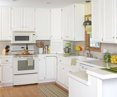New white paint on the kitchen cabinets and a sunny yellow paint on the walls brought the space fresh charm and made the room feel larger an...