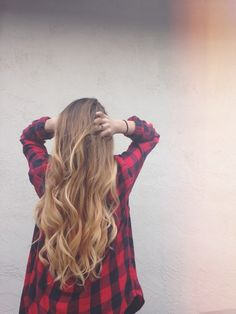 I don't know which piece of this picture I like more...the red flannel shirt or this girl's hair!!