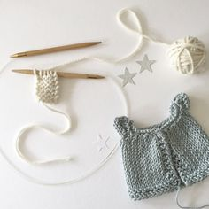 A little cardigan, made to order, for your luckyjuju kitty. We can discuss which colors/yarns are available.