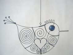 Wire Bird Hanging Sculpture, $26. This reminds me a little of Portlandia, but I like it anyway. Put a bird on it!