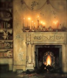 a beautiful old fireplace with mantel