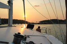 Sailing in Thailand:   Life's hard on the ocean wave.