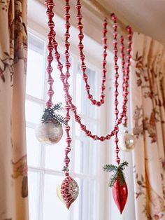 Christmas garland for windows For a seasonal window treatment, drape strands of beaded garland over a curtain rod, securing them with tape on the back. Wire elegant glass ornaments to the garland, and hot-glue sprigs of greenery to the ornament tops. Noel Christmas, Christmas Projects, All Things Christmas, Winter Christmas, Holiday Crafts, Holiday Fun, Vintage Christmas, Christmas Ornaments, Hanging Ornaments