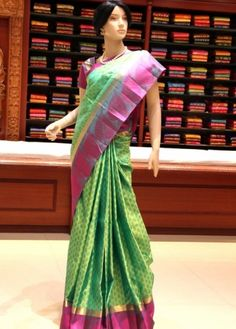 Parrot Green Colored Body with Pink Colored Fancy Thread Bordered Kanchipuram Pure Silk Saree. http://www.shreedevitextile.com/women/sarees/silk-saree/shree-devi/parrot-green-colored-kanchipuram-pure-silk-saree-1