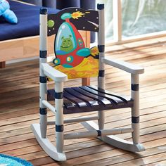 Features:  -Perfect for ages 2 and up.  -Porch suitable: Yes.  -Outdoor use details: Covered porch only.  -Outer Space collection.  Finish: -Multi-Colored.  Product Type: -Chair.  Frame Material: -Woo