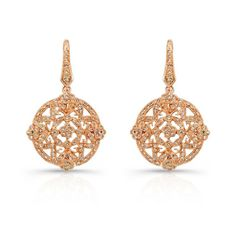 With mesmerizing details, these striking 18k rose gold earrings feature an intricate design with cognac diamonds. They are available in 18k white, rose and yellow gold, as well as platinum.