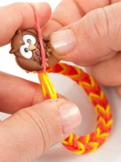 Create a Loom Band Bracelet with a cute button to complete the look!