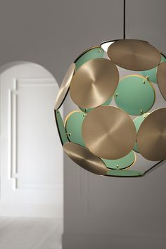 This is a beautiful ceiling pendant with circular discs that make up the lamp shade. This light is available in 8 different finishes, burnished brass, embossed black, burgundy, silk grey, antique pink, embossed white, sapphire blue and forest green. You have the choice of which finish you would like on the inside disc and the outside disc, please contact us to make this choice before buying.
