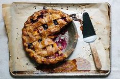 "Peaches and blueberries are combined for a perfect balance of sweet and tart in this late summer pie. Its hearty rye crust comes from Kim Boyce's book Good to the Grain. If you've never peeled peaches for pie before, it's easy as can be. Simply cut a shallow ""x"" into the bottom of each peach, then blanch them for one minute in boiling water. Shock the peaches in an ice bath and gently pull the skins off."