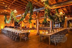 Photo by Artisan Events / Bliss weddings and events / architectual artifacts / Fall Wedding / Fall Wedding Flowers / Fall Wedding Decor / Chicago Wedding Planner /  Luxury Weddings / Chicago Event Planner / Rustic Modern Wedding / Rustic Wedding / Harvest Tables / Industrial Wedding / Warehouse Wedding / Hanging Greenery