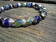Bracelet antiqued silver with cobalt indigo blue glass ,turquoise aurora borealis, antiqued silver beads. $10.99, via Etsy.