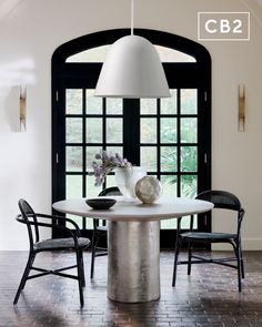 A modern, curvaceous design that comes to us from the Italian father/daughter duo behind Balutto Associati. Glam dining chair is framed in glossy black rattan with handwoven rattan for both back and seat. Anchored together with wrapped rattan for that extra dose of monochrome. Learn about Balutto Associati on our blog. CB2 exclusive. Rattan Dining Chairs, Furniture Dining Table, Home Furniture, Circular Dining Table, Mid Century Design, New Homes, Interior, January, Catalog