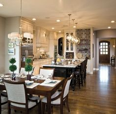 The shades on Progress Lighting's Ashbury chandelier paired with the exposed bulbs of the Equinox pendants accent this open floor plan. (Glenwyck Country Manor - Alon Estates, TX)