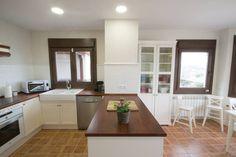 Cocina con península : Cozinhas clássicas por Canexel