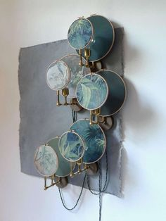 For Sale on 1stdibs - Circle blue grey, wall sconce ensemble, Sander Bottinga Handmade in brass, leather, wood and hand printed and painted linen. A dimmer is inlaid with leather.
