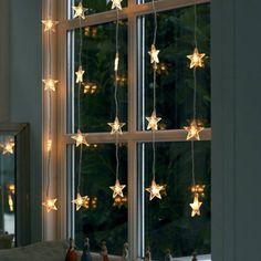 decor fereastra craciun beculete forma de stea