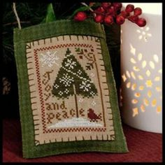 """""""Joy and Peace"""" is the title of this cross stitch pattern that is another addition to the Christmas Ornament Series for 2011. The model is ..."""
