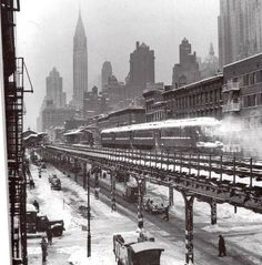 New York City circa 1950's: The Third Avenue El with the Chrysler Building silhouetted against the winter sky in the background. Photo courtesy of Todd Berkun.