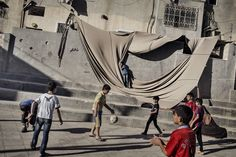 Adam Ferguson for The New York Times/Redux Children play soccer in a plaza in Al Fawwar, a Palestinian refugee camp in the West Bank, June 15, 2014.