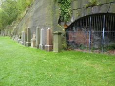 Graves along a wall
