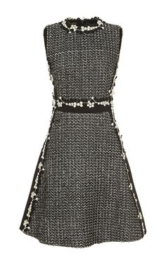 This **Giambattista Valli** dress is crafted from tweed and features floral embellishments along the side, waist, and collar.