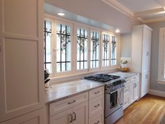 Kitchen, Gorgeous Stained Glass Bay Window Plus Light Wood Floor For Kitchen Idea And Compact White Mid Continent Cabinets ~ Bringing Catchy Kitchen Style through the Simplicity of Mid Continent Cabinets