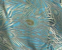 Gold peacock feathers embroidered onto silk