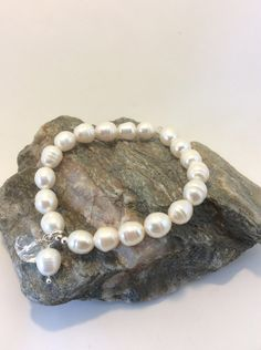 A personal favourite from my Etsy shop https://www.etsy.com/uk/listing/461309850/cultured-pearl-and-swarovski-bracelet