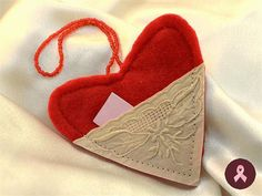 This is perfect for your Valentine decor! Red, felt heart, decorated with a white embroidered pocket, where you can hide your love whispers note.