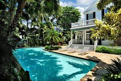 Another Key West, Florida gem surrounded by lush tropical foliage. Truman Annex by Craig Reynolds Landscape Architecture    - CountryLiving.com