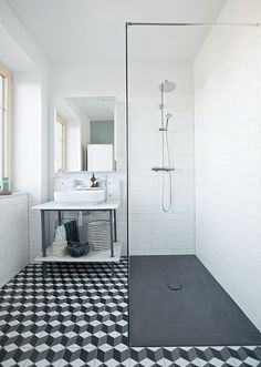 Walk in shower,  black and white bathroom .