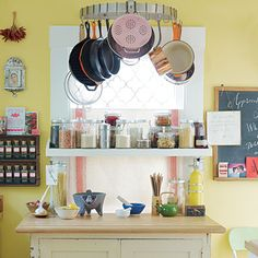 Hanging pots, cookbooks libraries, and jars storing colorful grains make for a colorful (and practical) display.