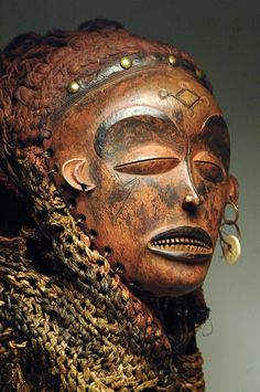 Africa | Mask from the Chokwe people of DR Congo, Angola or Zambia | Wood, raffia, cloth, metal, rope | ca. early 20th century