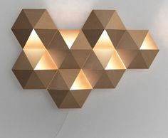 NBT Studio's Ambihive is a LED Lamp and Sound System Packed Into a Single Cardboard Wall Fixture