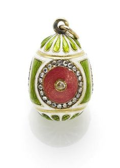 A miniature pendant egg by Fabergé, workmaster Henrik Wigstrom, St. Petersburg, circa 1900, the body with white opaque and translucent green enamel sections surrounding four pink circular rose-cut diamond and enamelled panels.