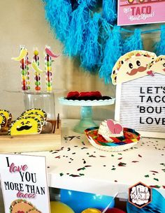 Gumball holders, taco cookies, and candy-filled sombrero from a Taco Bout Love Valentine Taco Party | Mandy's Party Printables #valentineparty #tacoparty #tacoboutlove #ilovetacos #MPP #fiesta