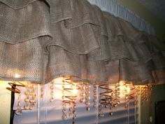 Suzette's burlap, bling, and rusty bed springs...stunning!  I think I will be making some burlap window covers for the kitchen/dining room