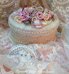 Idea for decorating plain box into a pretty keepsake or gift box - cover with pretty fabric or paper and add handmade flowers.