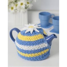 Daisy Motif Tea Cozy--maybe a pom pom on top in place of the daisy.