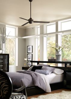 """With a minimalist, industrial design and ENERGY STAR rating, the 54"""" Sleek fan by Monte Carlo not only complements a wide variety of room styles, but also delivers powerful air flow and energy savings. It is offered in five finishes (Roman Bronze shown here)  #MonteCarlo #ModernCeilingFan #Bedroom #ENERGYSTAR"""